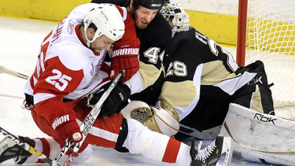 Brooks Orpik takes on Detroit's Darren McCarty in front of goalie Marc-Andre Fleury in Game 4 of the Stanley Cup final. Orpik appears to be 1 or 1A on GM Ray Shero's wish list.