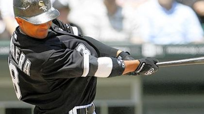 The White Sox's Orlando Cabrera hits a three-run home run against the Pirates in the second inning yesterday in Chicago.