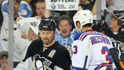 Could this man tank a game? Gary Roberts stares down New York's Michael Rozsival Sunday.