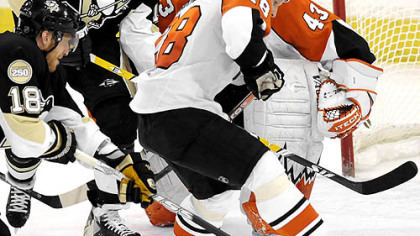 Penguins Marian Hossa reaches in to score on Flyers goalie Martin Biron in the second period.