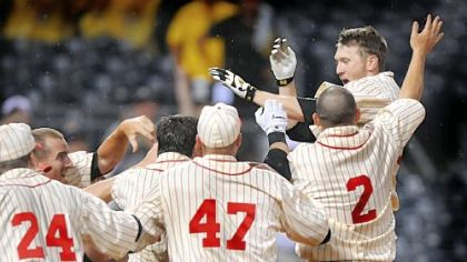 Jason Bay jumps on home plate and is mobbed by teammates after his solo home run in the 13th inning gave the Pirates a 4-3 win against Tampa Bay last night at PNC Park.