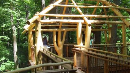 The Adirondack-style Lookout Loft treehouse at Longwood Gardens has two viewing platforms connected by a walkway. Visitors reach it on a long winding ramp that is handicapped-accessible.