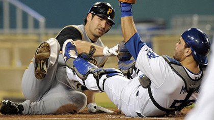 Dodgers catcher Russell Martin holds up his glove after tagging out the Pirates' Xavier Nady at home plate during second the inning of their baseball game last night.