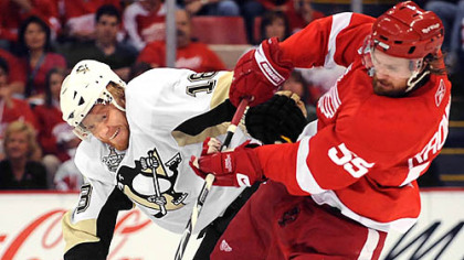 Penguins' Marian Hossa battles with Red Wings' Niklas Kronwall.