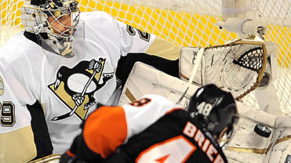 Penguins goalie Marc-Andre Fleury makes a save on Flyers Danny Briere.