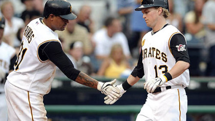 Luis Rivas congratulates Nate McLouth after McLouth hit a home run in the second inning last night in the Pirates' 10-7 victory against the Houston Astros. The victory opened a seven-game homestand for the Pirates before the All-Star break.