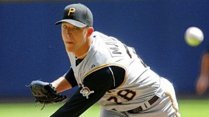 Pirates starter Paul Maholm works to a Milwaukee batter in the first inning yesterday.