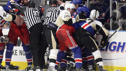New York Rangers' Paul Mara, left, is held back by linesman Jean Morin during a scuffle with the Penguins' Evgeni Malkin after Rangers' Jaromir Jagr scored with 14 seconds left in the third period during Game 4 of an NHL Eastern Conference semifinal hockey playoff series Thursday, in New York. The Rangers won 3-0.