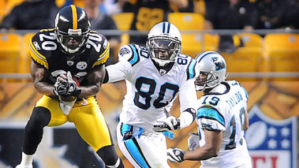Bryant McFadden makes one of two interceptions the Steelers had against Carolina's Matt Moore in the first half last night.