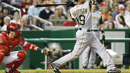 The Pirates' Jose Bautista follows through with a home run in the third inning of an baseball game against the Washington Nationals, yesterday in Washington. At left is Washington Nationals catcher Wil Nieves.