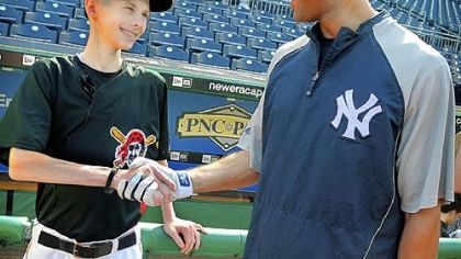 John Challis meets one of his baseball heroes, Yankee shortstop Derek Jeter, at PNC Park in June.