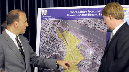 Allegheny County Chief Executive Dan Onorato views a map showing the 78 acres known as Montour Junction, donated by the Sports Legacy Foundation for a new county sports and athletic complex.
