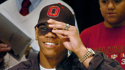 Terrelle Pryor puts on an Ohio State hat to announce his college choice March 19.