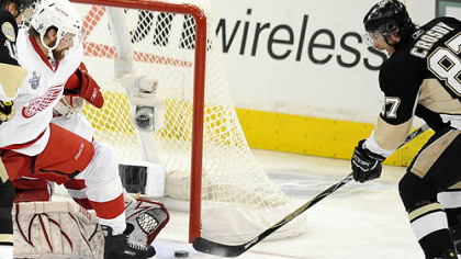 Sidney Crosby gets his second  goal of the night against the Red Wings' Chris Osgood in the second period.