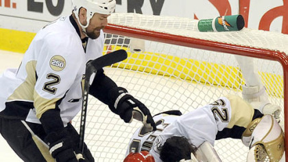 Red Wings' Valtteri Filppula crashes into goalie Marc-Andre Fleury in the first period.