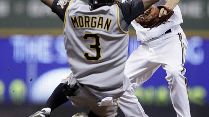 Nyjer Morgan (3) breaks up a double play as he slides into Milwaukee Brewers shortstop J.J. Hardy during the seventh inning of yesterday's game in Milwaukee. The Pirates' Freddy Sanchez was safe at first.