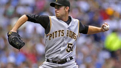 Pirates starting pitcher Zach Duke winds up against the Milwaukee Brewers in the second inning last night.