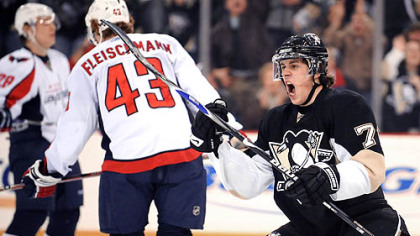 Evgeni Malkin celebrates after scoring in the first period against the Capitals last night at Mellon Arena.