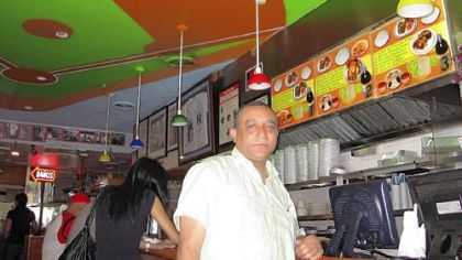Restaurant owner and friend of Pedro Alvarez's family, Miguel Montas, inside his restaurant El Nuevo Caridad, in Washington Heights, New York City.