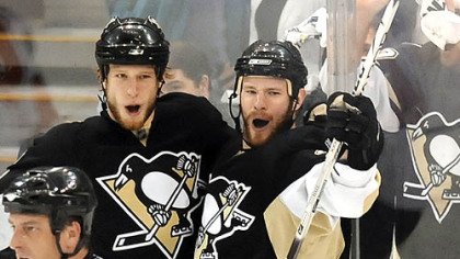 Penguins Jordan Staal celebrates his second period goal with teammate Adam Hall Sunday.