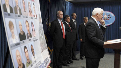 Pennsylvania Attorney General Tom Corbett, right, yesterday announces grand jury presentments in the bonusgate scandal investigation.