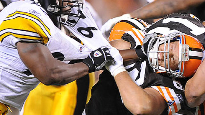 James Harrison stiff arms the Browns' Steve Heiden.