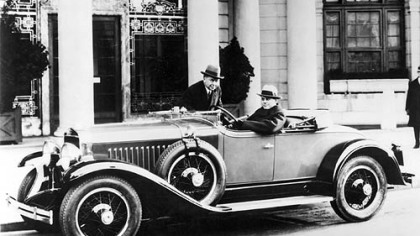 A 1927 LaSalle, the first production car designed by Harley Earl, at wheel, who is considered the father of automotive design.