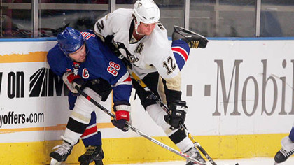 Ryan Malone battles New York's Jaromir Jagr for the puck last night at Madison Square Garden.