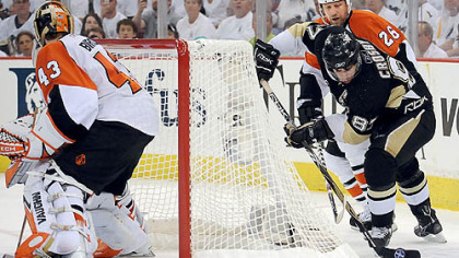 The Penguins&#039; Sidney Crosby wraps a puck around the net against the Flyers at the Mellon Arena last night.