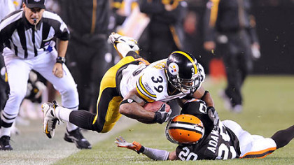 Steelers running back Willie Parker is tackled by the Browns' Mike Adams last night.