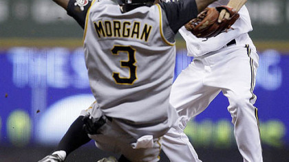 Nyjer Morgan  breaks up a double play as he slides into Brewers shortstop J.J. Hardy during the seventh inning of yesterday's game in Milwaukee. The Pirates' Freddy Sanchez was safe at first.