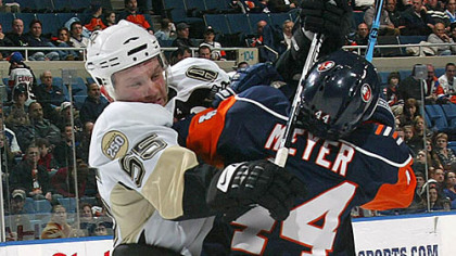 Sergei Gonchar hits the Islanders' Freddy Meyer with his stick last night at the Nassau Coliseum.