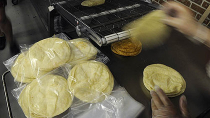 Freshly made flour tortillas are packaged at Reyna Foods on Penn Avenue in the Strip District.