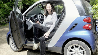 Patti Hollingshead with her new Smart car.