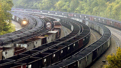 Railcars, some loaded with coal, others empty, line a hollow in the coal-rich region of Mingo County, W.Va.