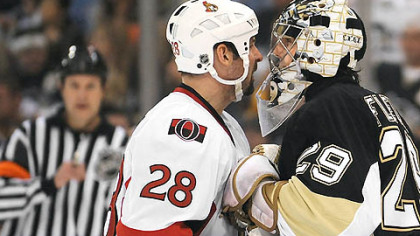 Marc-Andre Fleury goes face-to-face with the Senators&#039; Martin Lapointe in the second period at the Mellon Arena last night.