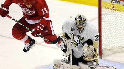 Marc-Andre Fleury makes a save against Red Wings Dan Cleary in the third period.