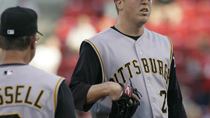 Pirates pitcher Tom Gorzelanny, right, waits to be taken out by manager John Russell in the first inning of last night's game against the Cincinnati Reds.