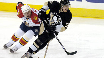 Evgeni Malkin gets around Florida's Jozef Stumpel. Malkin scored his eighth goal in the past eight games.