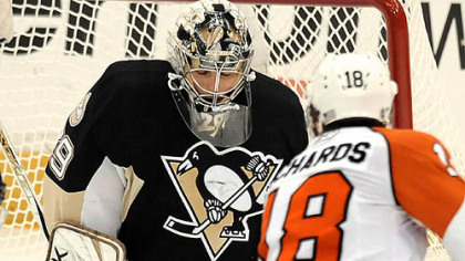 Penguins Marc-Andre Fleury makes a save on Flyers Mike Richards in the first period Sunday.