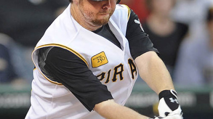 Phil Dumatrait gets a hit in the Pirates' four-run first inning.