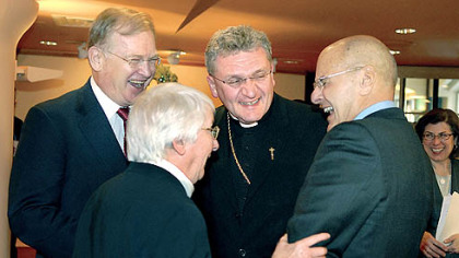 Left to right, Jack McGinley, board chairman, Sister Margaret Hannan, president, Sisters of Mercy, and Bishop David A. Zubik, joke with Jeffrey Romoff, president and CEO of UPMC, after the Celebration of Remembrance, Thanksgiving and Transition ceremony at the Holy Family Chapel at UPMC Mercy.