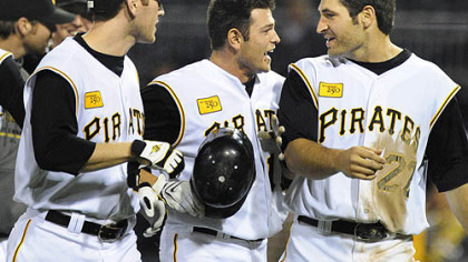 The Pirates' Freddy Sanchez, center, is congratulated by Jason Bay, left, and Xavier Nady, right, after Sanchez hit a game-winning single in the bottom of the ninth inning of last night's game to give the Pirates a 3-2 victory over the Atlanta Braves at PNC Park.