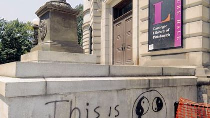 Graffiti vandals have tagged two quotes on the side of the Carnegie Library in Oakland.