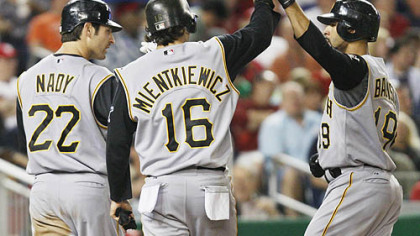 The Pirates' Jose Bautista, right, celebrates with teammates Xavier Nady , and Doug Mientkiewicz after they both scored on Bautista's three-run home run during the third inning of a baseball game against the Washington Nationals, last night in Washington.
