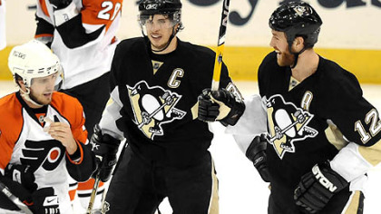 Penguins Ryan Malone celebrates his second period goal with teammate Sidney Crosby Sunday.