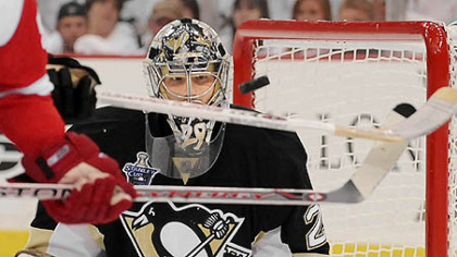 Penguins goalie Marc-Andre Fleury makes save on Red Wings Johan Franzen.