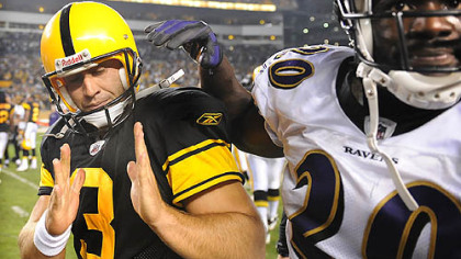 Jeff Reed, left, shows Baltimore's Ed Reed how close his winning kick in overtime was to the upright. The kick helped Reed earn AFC special teams player of the week.