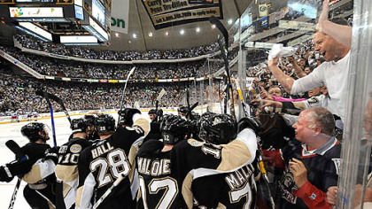 The Penguins celebrate after Marian Hossa's overtime goal against the Rangers yesterday at Mellon Arena.