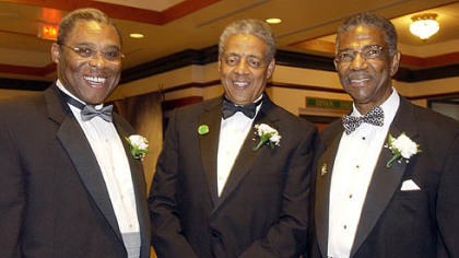 Dwight White, left, Tom Burley, and Thomas Motley, right at a FROGS formal event in 2004.